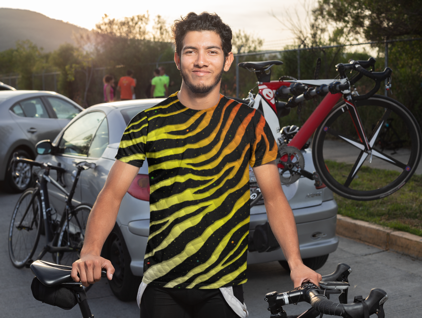 Cycling guy in a white/yellow/red Ripped Spacetime Stripes t-shirt.